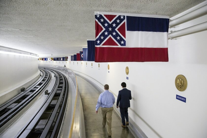 The Mississippi state flag is displayed with the banners of other American states, territories and commonwealths, above a walkway in the tunnel from the Capitol Building to the Dirksen Senate Office Building in Washington, Friday, July 1, 2016. The flag is unique among U.S. state flags as it is the