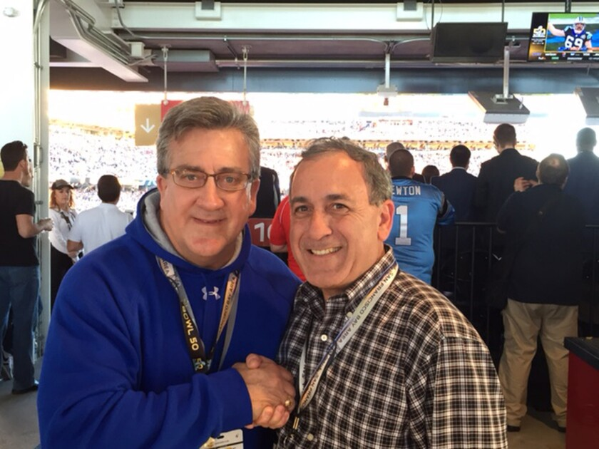 Former Iran hostage, Rocky Sickmann, left, with Alex Paen, at Super Bowl 50. Paen was able to bring audio recordings of Super Bowl XIV to the hostages.