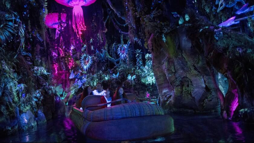 Visitors ride the Na'vi River Journey in Pandora - World of Avatar at Disney's Animal Kingdom in Florida.