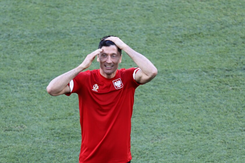 Poland's Robert Lewandowski smiles during training session at the La Cartuja stadium in Seville, Spain, Friday, June 18, 2021. Poland will play against Spain on Saturday for the Group E of the Euro 2020 soccer championship. (Jose Manuel Vidal/Pool via AP)