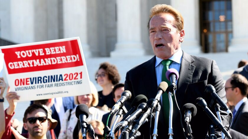 Former California Gov. Arnold Schwarzenegger speaks at a rally outside the U.S. Supreme Court on Oct. 3 on the need for fair redistricting, the drawing of political map boundary lines.