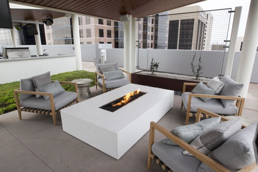 One of the rooftop seating areas at The Rey with views of the Symphony Towers and San Diego Union-Tribune building.