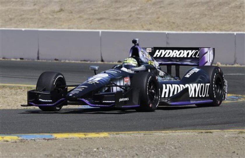 Tony Kanaan, of Brazil heads through a turn during practice for the IndyCar auto race in Sonoma, Calif., Saturday, Aug. 24, 2013. (AP Photo/Rich Pedroncelli)