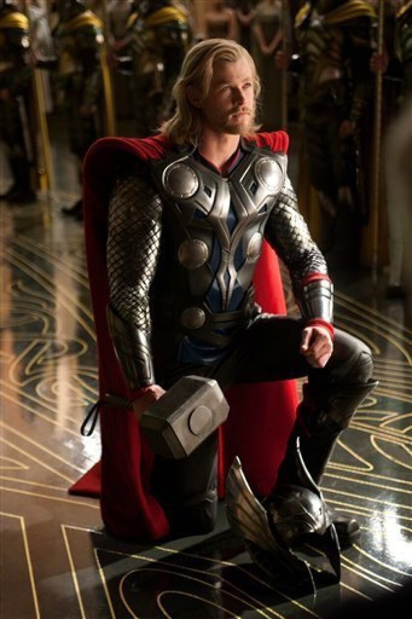 "In this film publicity image released by Paramount Pictures, Chris Hemsworth portrays the title character in a scene from the film, ""Thor."" (AP Photo/Paramount Pictures-Marvel Studios, Zade Rosenthal)"