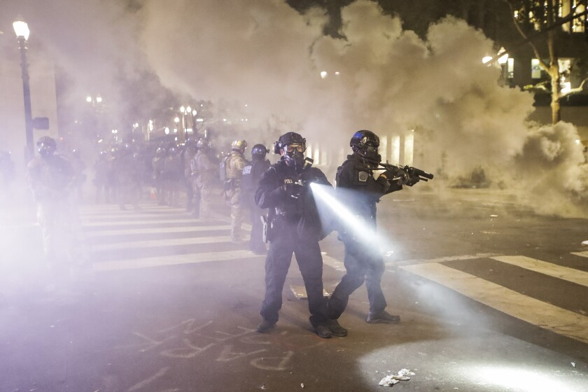 Federal officers deploy tear gas in Portland, Ore., on Tuesday