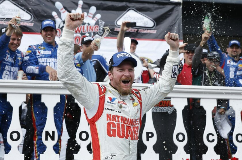 Dale Earnhardt Jr. celebrates in Victory Lane after winning the NASCAR Sprint Cup Series auto race at Pocono Raceway, Sunday, Aug. 3, 2014, in Long Pond, Pa. (AP Photo/Matt Slocum)