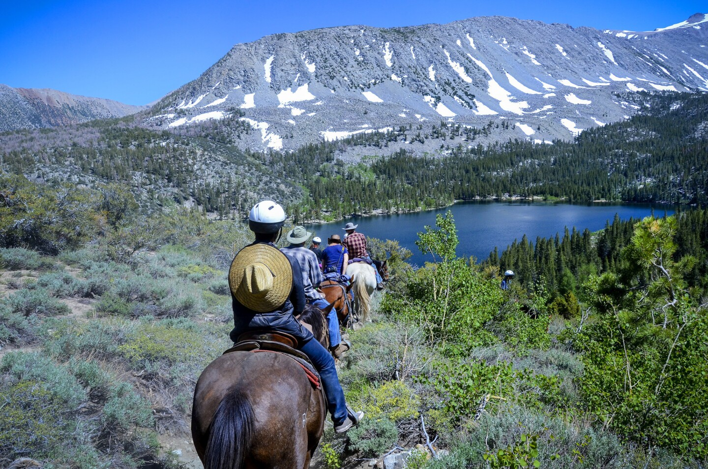 Guests and packers from Rock Creek Pack Station start their ride back to the station from Davis Lake.