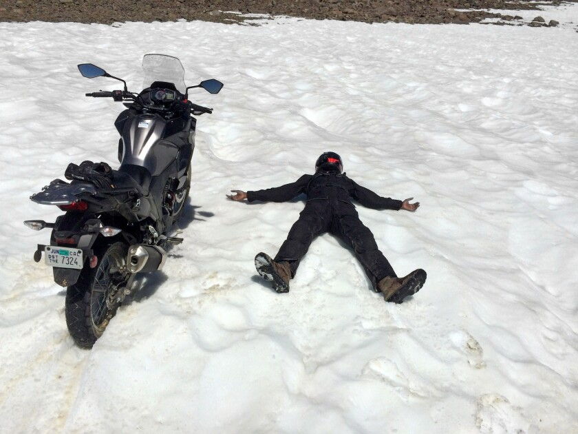 We didn't expect to see snow in July, even at 12,000 feet. Abhi expressed his enthusiasm by riding t