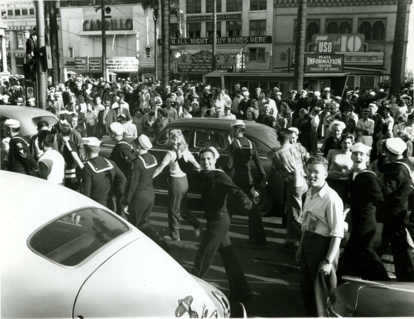 San Diegans spill onto Broadway, celebrating the news of Japan's surrender.