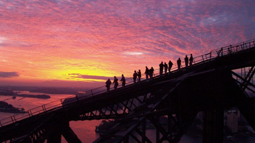 AUSTRALIA-- Group of climbers during the descent at sunset of BridgeClimb Sydney.