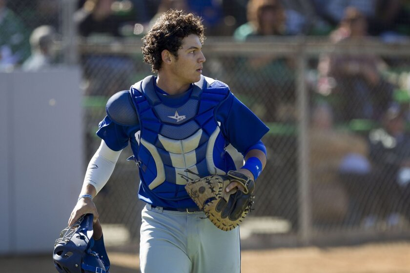 Rancho Bernardo catcher Alex Jackson (shown in a photo earlier this season) had a three-run double to help the Broncos defeat Carlsbad on Friday.
