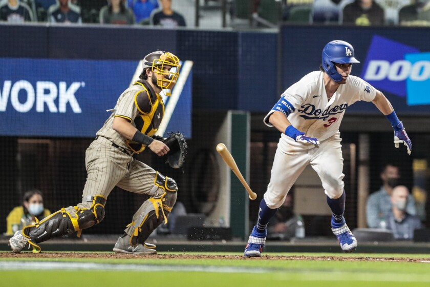 Cody Bellinger drops the bat to run to first after hitting a grounder for an error and the tying run.