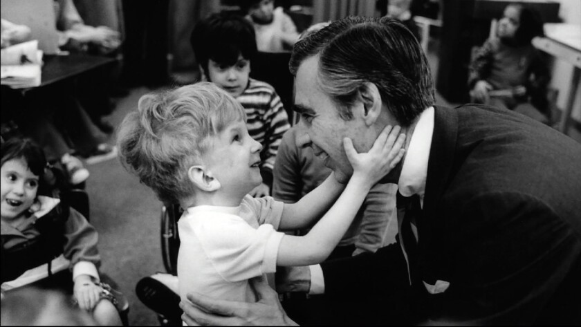 Fred Rogers (right) meets with a disabled boy in the film WON'T YOU BE MY NEIGHBOR?, a Focus Feature