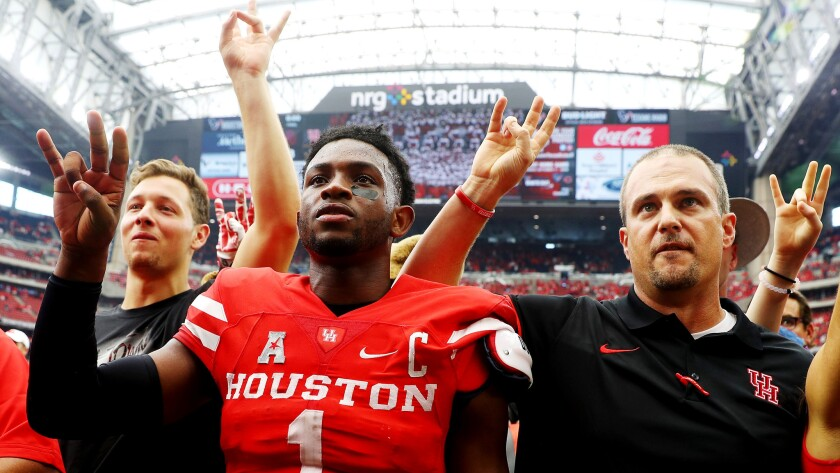 Houston Coach Tom Herman, right, and quarterback Greg Ward Jr. (1) celebrate their victory over Oklahoma on Saturday.