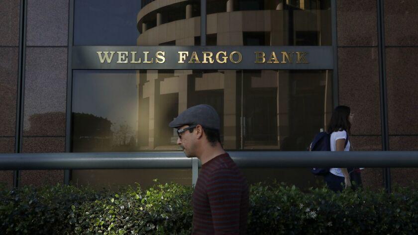 Pedestrians walk past a Wells Fargo branch in downtown Los Angeles.