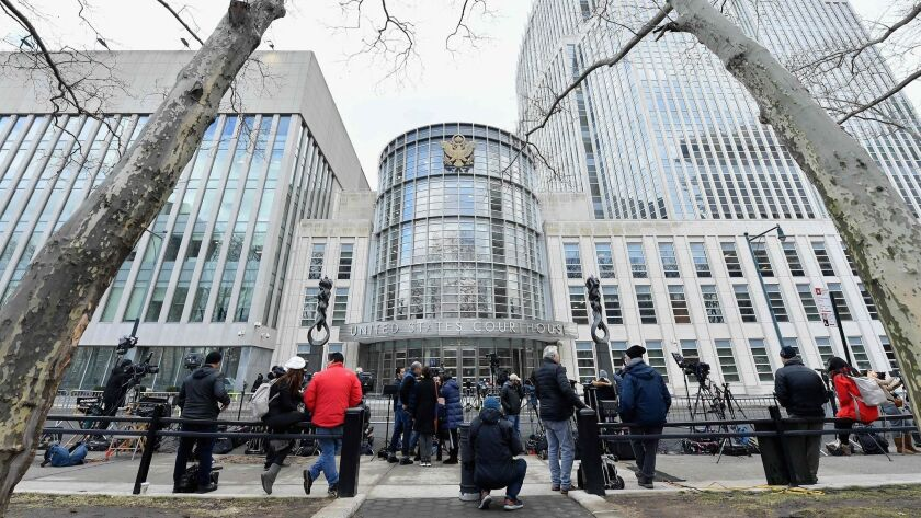 """Members of the media gather in front of the U.S. Courthouse in Brooklyn on Tuesday during the trial of Joaquin """"El Chapo"""" Guzman."""