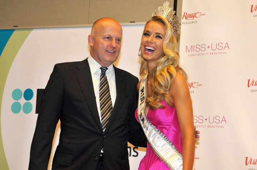 Reelz Chief Executive Stan E. Hubbard poses with Miss USA Olivia Jordan of Oklahoma at the 2015 Miss USA Pageant.