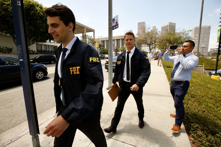 FBI agents leave the downtown headquarters of the Los Angeles Department of Water and Power after serving a search warrant Monday, July 22, 2019.