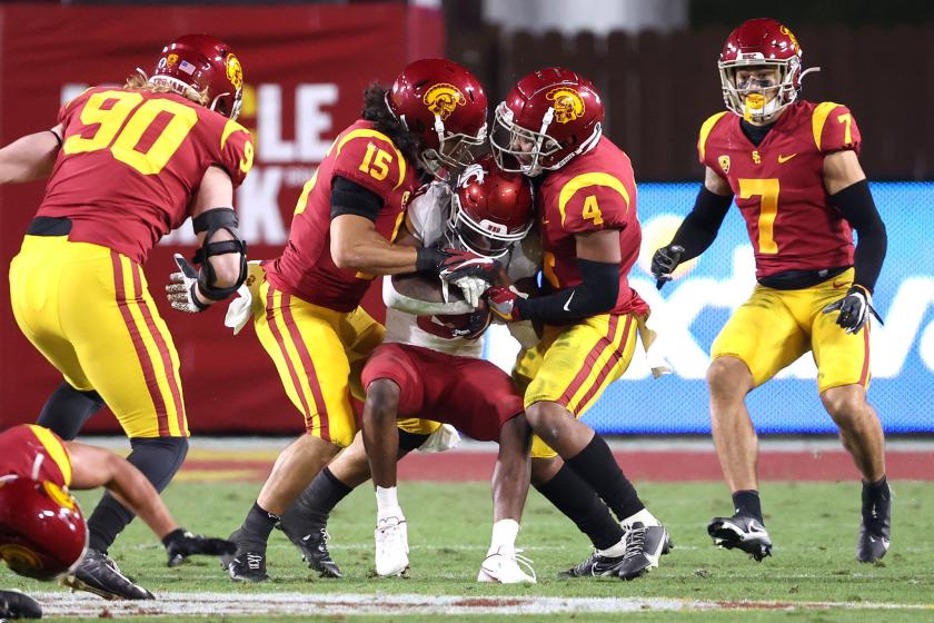 USC safeties Talanoa Hufanga and Max Williams tackle Washington State wide receiver Calvin Jackson Jr.