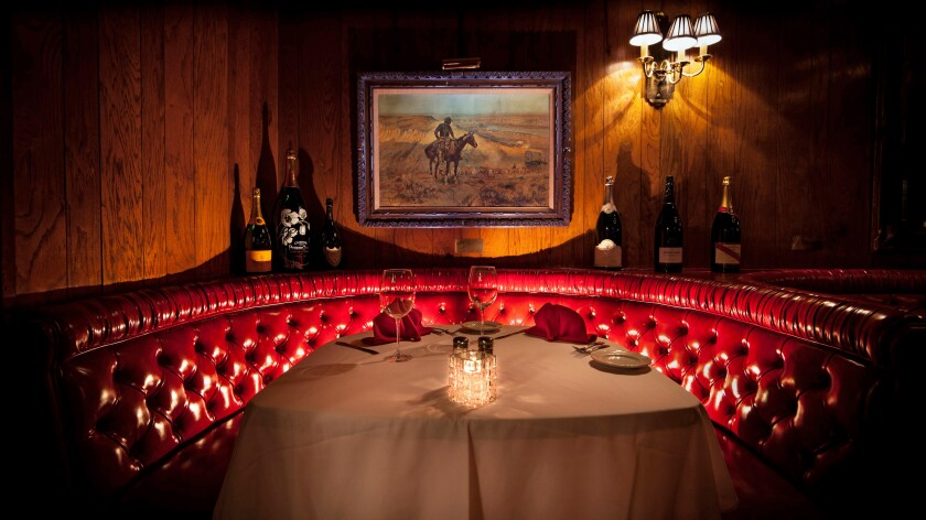 A red leather booth at the upscale Golden Steer.
