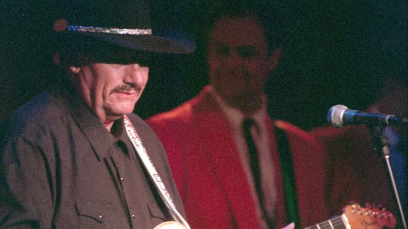 Guitarist Nokie Edwards, shown during a 1996 performance in Orange County, died March 12 at age 82.