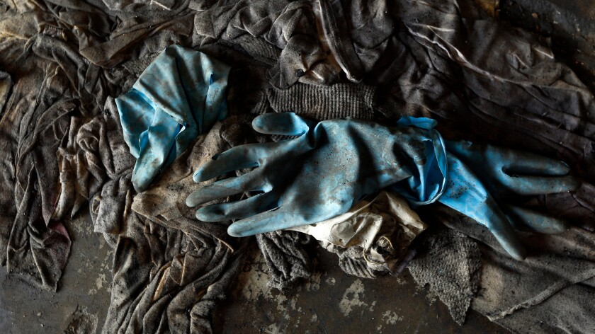 Work gloves and old clothing found after the Sept. 11 attack.
