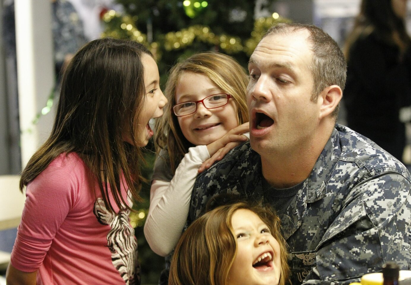 USS Ronald Reagan Sailors Receive Holiday Meal
