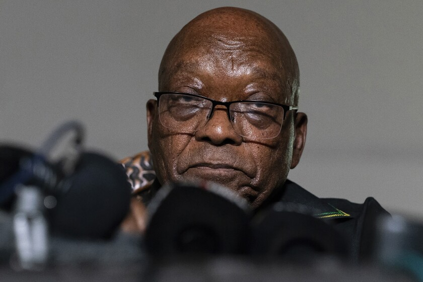 FILE - In this Sunday, July 4, 2021 file photo, former President Jacob Zuma addresses the press at his home in Nkandla, KwaZulu-Natal Province, South Africa. Zuma has been granted medical parole, after serving two months of a 15-month sentence for contempt of court. (AP Photo/Shiraaz Mohamed, File)