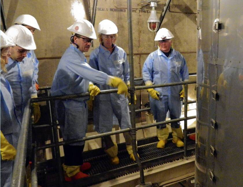 Allison Macfarlane, second from right, head of the U.S. Nuclear Regulatory Commission, tours the troubled San Onofre nuclear power plant. She offered assurance that the facility will remain closed until its safety is certain but gave few hints about its ultimate fate.