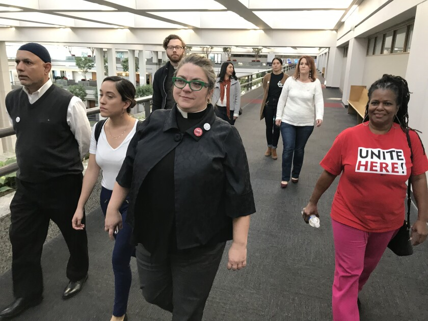 Union members and clergy supporting Unite Here met with Loyola Marymount University officials in Los Angeles on Monday to push for a resolution to a contract dispute that is threatening Thursday's Democratic presidential debate.