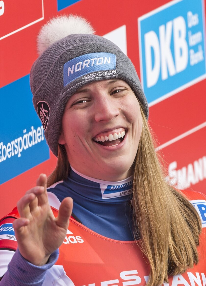 Erin Hamlin of  the US smiles  after  the women luge World Cup race in Altenberg, eastern Germany, Sunday, Feb. 14, 2016. She placed sixth. (AP Photo/Jens Meyer)