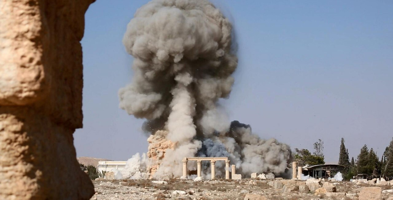 Smoke rises from an explosion that destroyed the Temple of Baalshamin in Syria's ancient city of Palmyra.