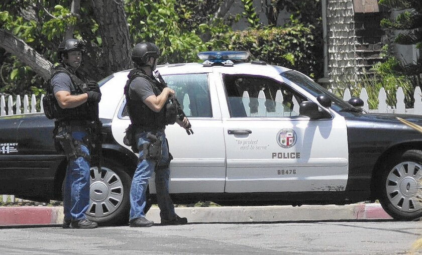 LAPD officers close off Hartsook Street as police search for gunmen in North Hollywood in June. After years of decline in violent crime totals, the city is seeing more incidents this year than last, driven by an uptick in aggravated assaults.