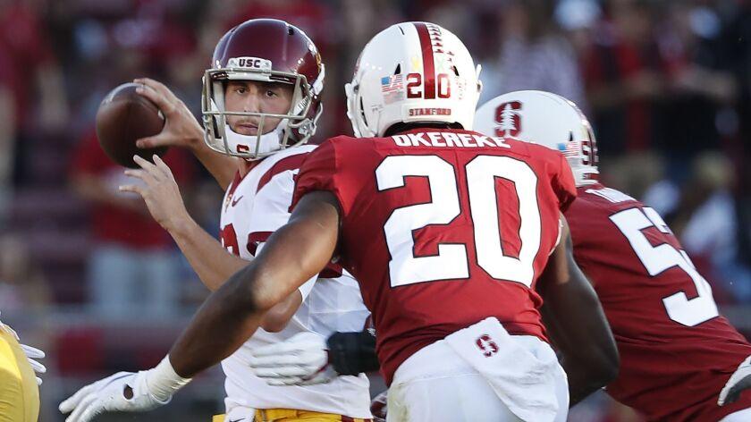 Southern California quarterback Matt Fink (19) throws a pass under pressure by Stanford linebacker B