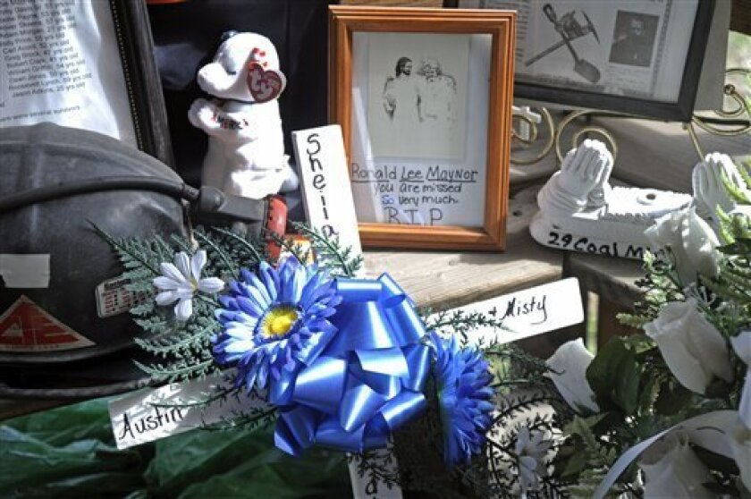 In this March 8, 2011 photo, a memorial for the Upper Big Branch coal miners is displayed in Whitesville, W.Va. Twenty-nine men died deep inside Massey Energy's Upper Big Branch mine on April 5, 2010 near Montcoal. It was the deadliest U.S. coal mining accident since 1970, and remains the target of civil and criminal investigations. (AP Photo/Jeff Gentner)