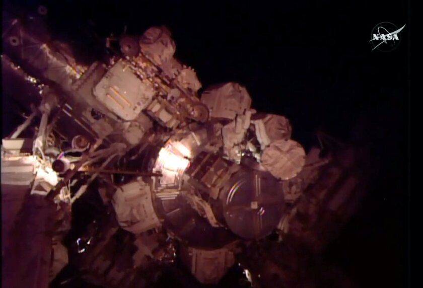 In this frame grab from NASA Television, astronauts Scott Kelly and Kjell Lindgren perform maintenance outside the International Space Station, on Friday, Nov. 6, 2015.  Friday's excursion involves work on the space station's cooling system.  Kelly has been at the 250-mile-high outpost since March,