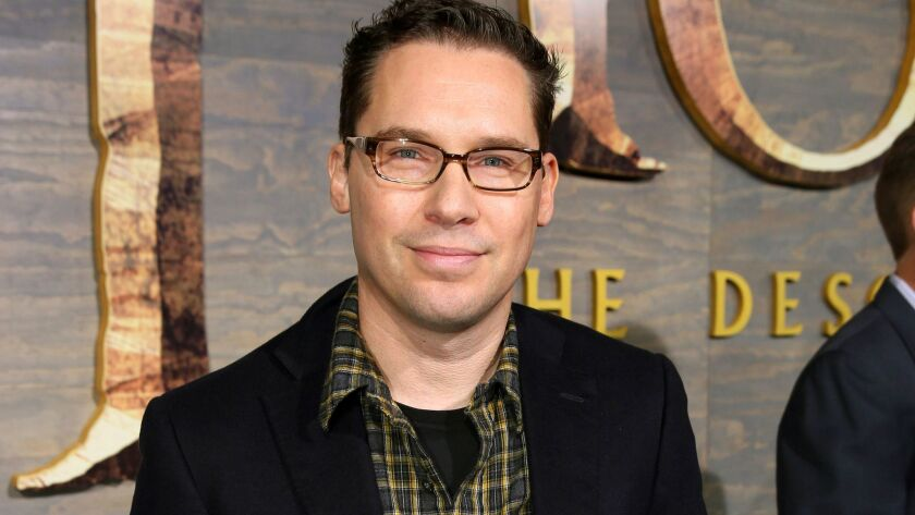 "Director Bryan Singer, who has left the Queen biopic ""Bohemian Rhapsody"" in the middle of production, faces a lawsuit over alleged sexual assault of a teen in 2003."