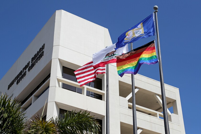 The city of Huntington Beach raised the LGBTQ Pride flag at City Hall for the first time on Saturday.