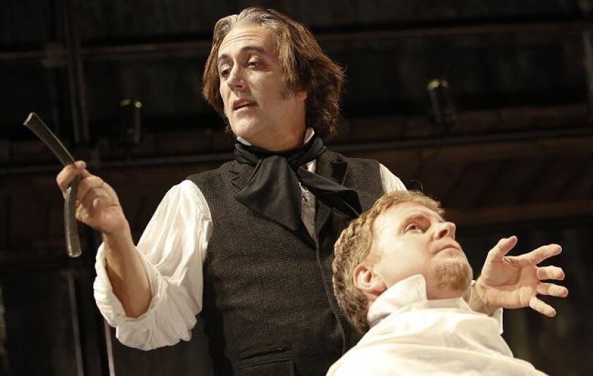 """Sean Murray (left) directs and takes the starring role in """"Sweeney Todd"""" at Cygnet's Old Town Theatre. The unlucky gent in the chair is Steve Gunderson as Judge Turpin."""