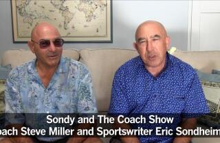 Sondy and coach on prep sports
