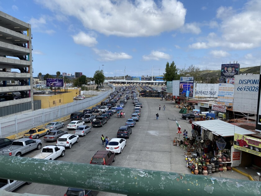 Though new coronavirus border regulations have not been relaxed in recent days, traffic to cross into the United States at the San Ysidro Port of Entry from Tijuana backed up nearly a mile on April 21. San Diego and Tijuana have a highly integrated binational economy.