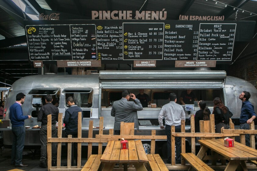 May 8, 2018 - Customers wait in front of the Airstream at Pinche Gringo to order lunch. Pinche Grin