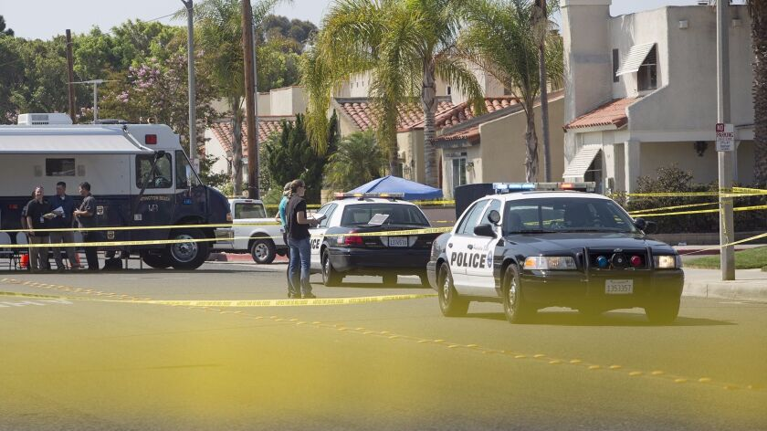 Huntington Beach police investigate a shooting involving two officers at a residence along Delaware Street, near Utica Avenue, in Huntington Beach.