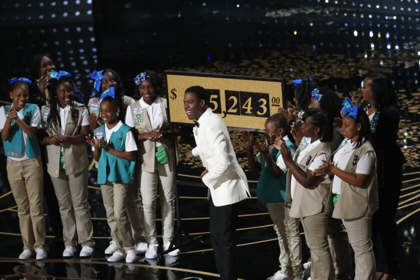 Chris Rock and Girl Scouts from an Inglewood troop. during the telecast of the 88th Academy Awards on Sunday. Money raised during the show will go to an Inglewood troop.