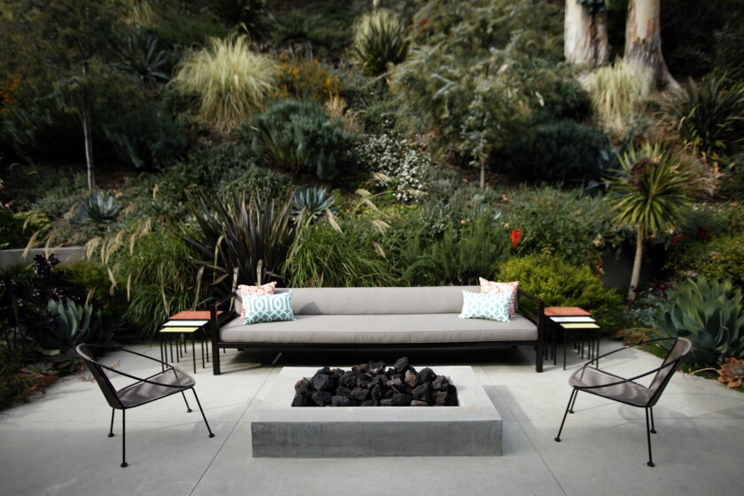 Landscape designer Judy Kameon designed an extra-long sofa and fire pit for an outdoor seating area in this 1953 Brentwood ranch house.
