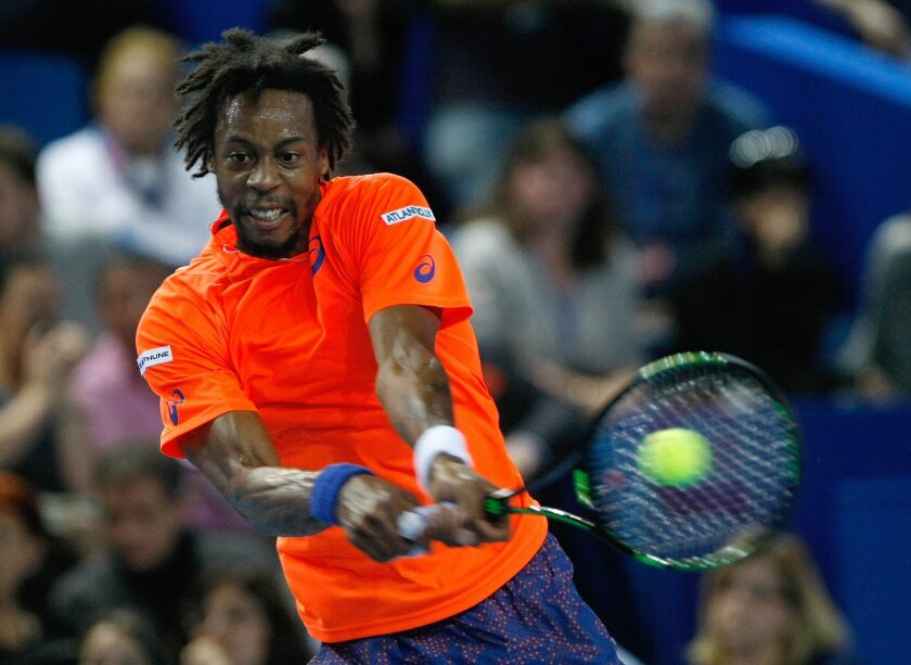 France's Gael Monfils returns the ball to France's Gilles Simon, during their final match, at the Open 13 tennis tournament, in Marseille, southern France, Sunday, Feb. 22 , 2015. (AP Photo/Claude Paris)