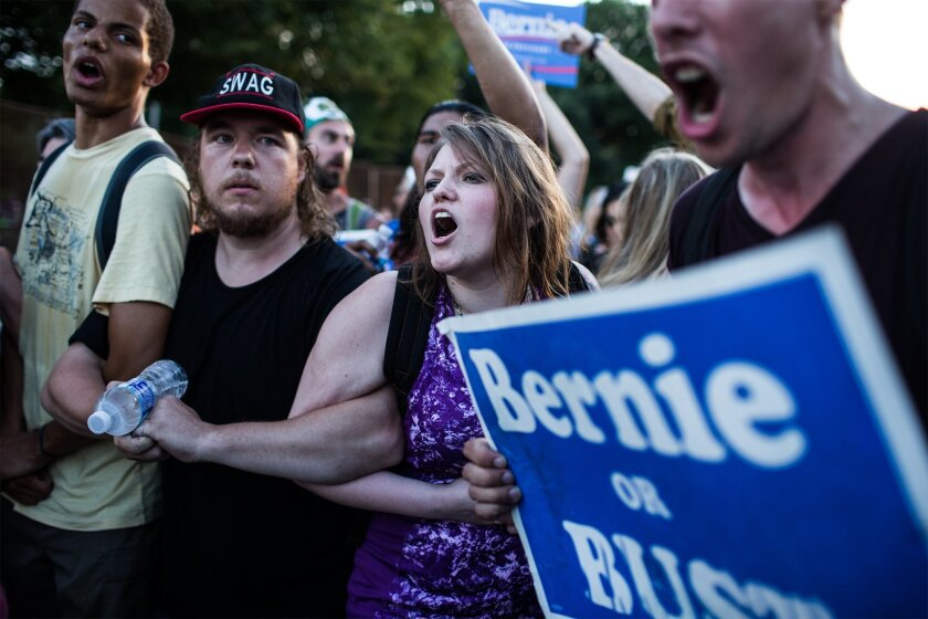 Supporters of former Democratic presidential candidate, Sen. Bernie Sanders, I-Vt., protest during the second day of the Democratic National Convention in Philadelphia, Tuesday, July 26, 2016.  (Sean Simmers/PennLive.com via AP)