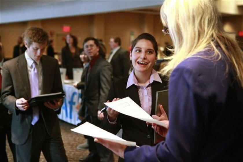 Stephanie Buckley, of Boston, second from right, has her resume reviewed by Shelly Piper, of Cape Ann, Mass., right, at the BostonHires job fair in a hotel in Boston, Tuesday, Feb. 2, 2010. Unemployment rose in most cities and counties in December, signaling that companies remain reluctant to hire even as the economy recovers.(AP Photo/Steven Senne)
