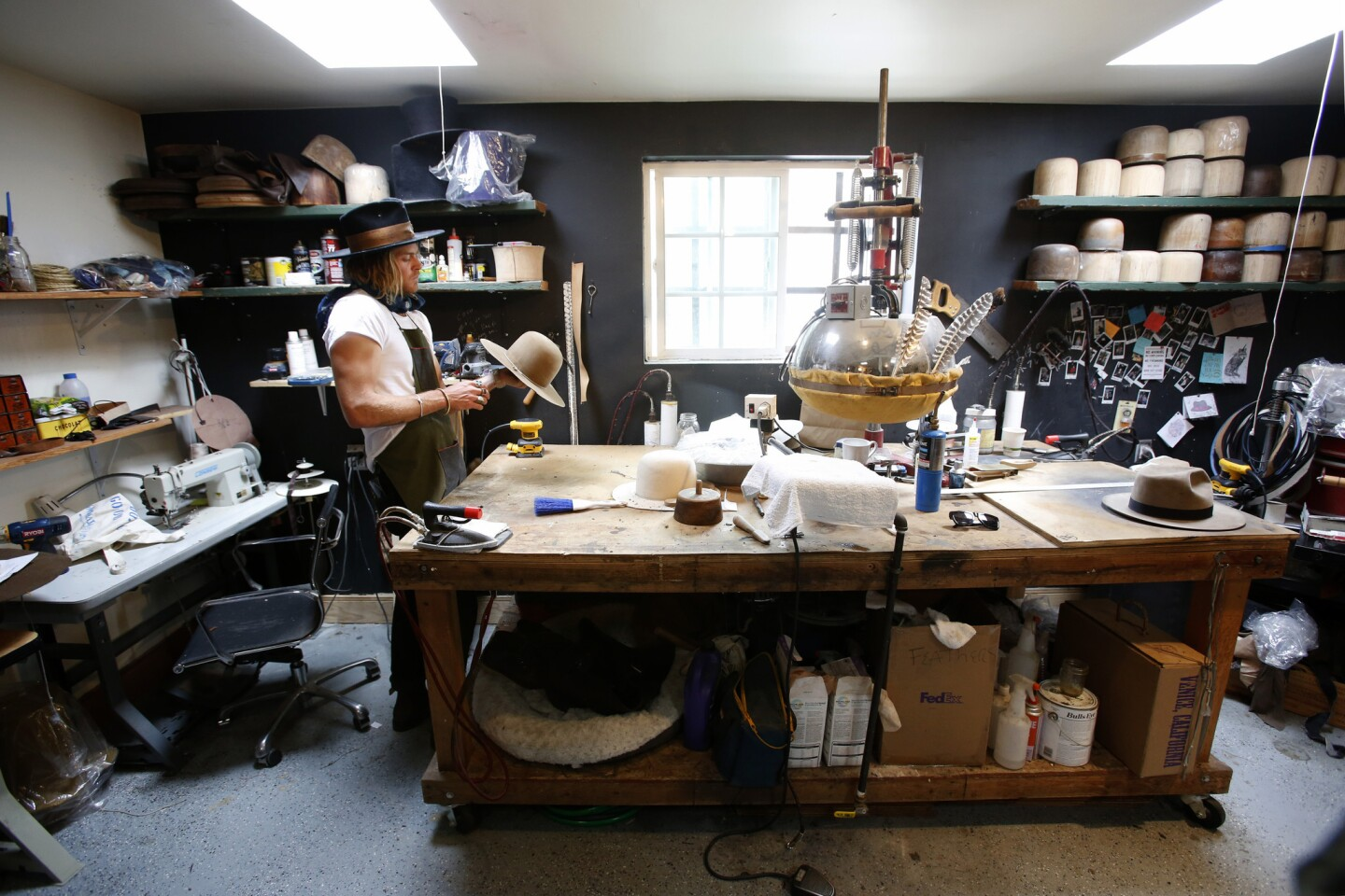 Nick Fouquet, who is also a model, handcrafts one-of-a-kind hats in his Venice studio. His creations have become popular among celebrities such as Madonna and Pharrell Williams.