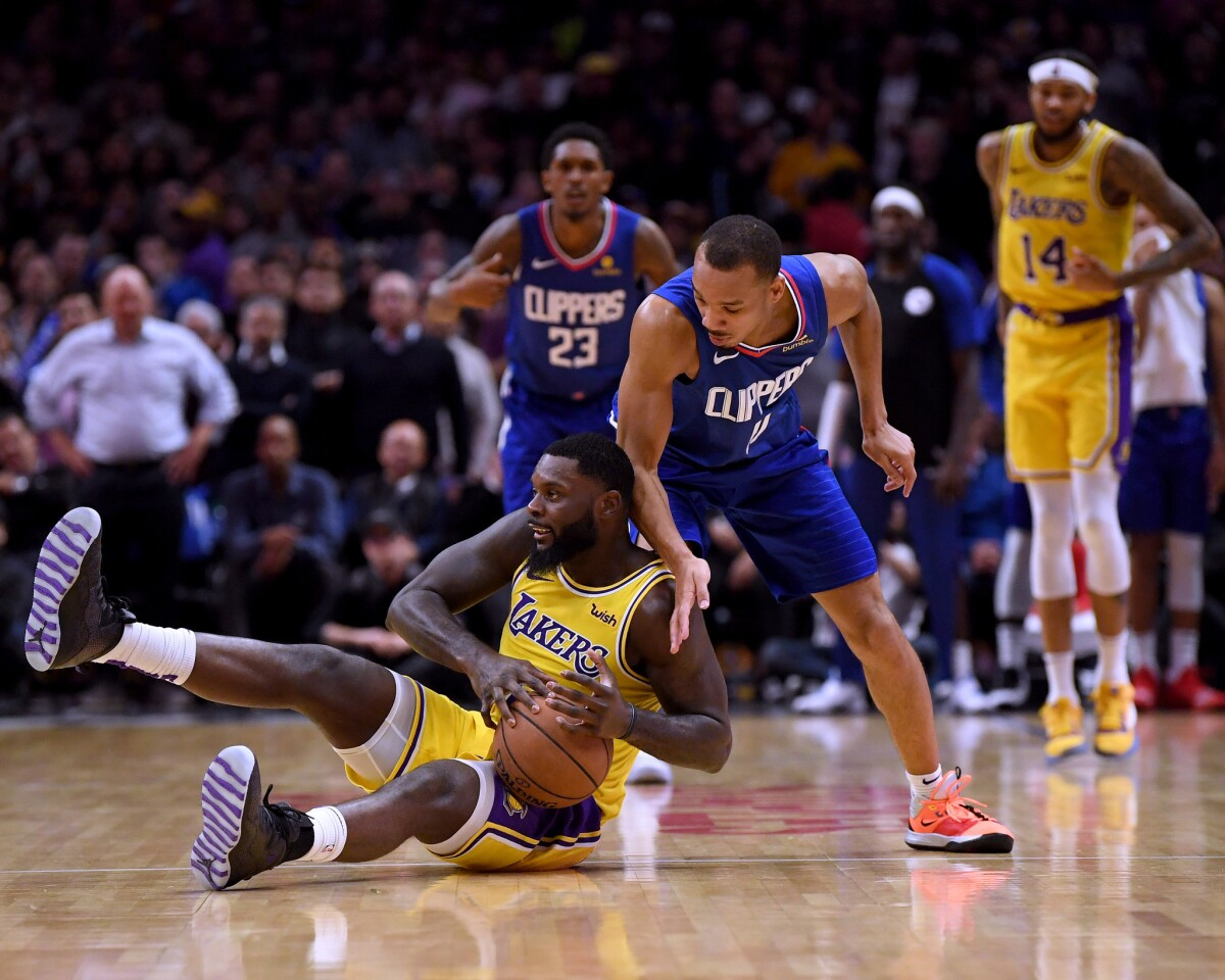LOS ANGELES, CALIFORNIA - JANUARY 31: Lance Stephenson #6 of the Los Angeles Lakers tries to protect the ball from Avery Bradley #11 of the LA Clippers during a 123-120 Laker win at Staples Center on January 31, 2019 in Los Angeles, California. NOTE TO USER: User expressly acknowledges and agrees that, by downloading and or using this photograph, User is consenting to the terms and conditions of the Getty Images License Agreement. (Photo by Harry How/Getty Images) ** OUTS - ELSENT, FPG, CM - OUTS * NM, PH, VA if sourced by CT, LA or MoD **